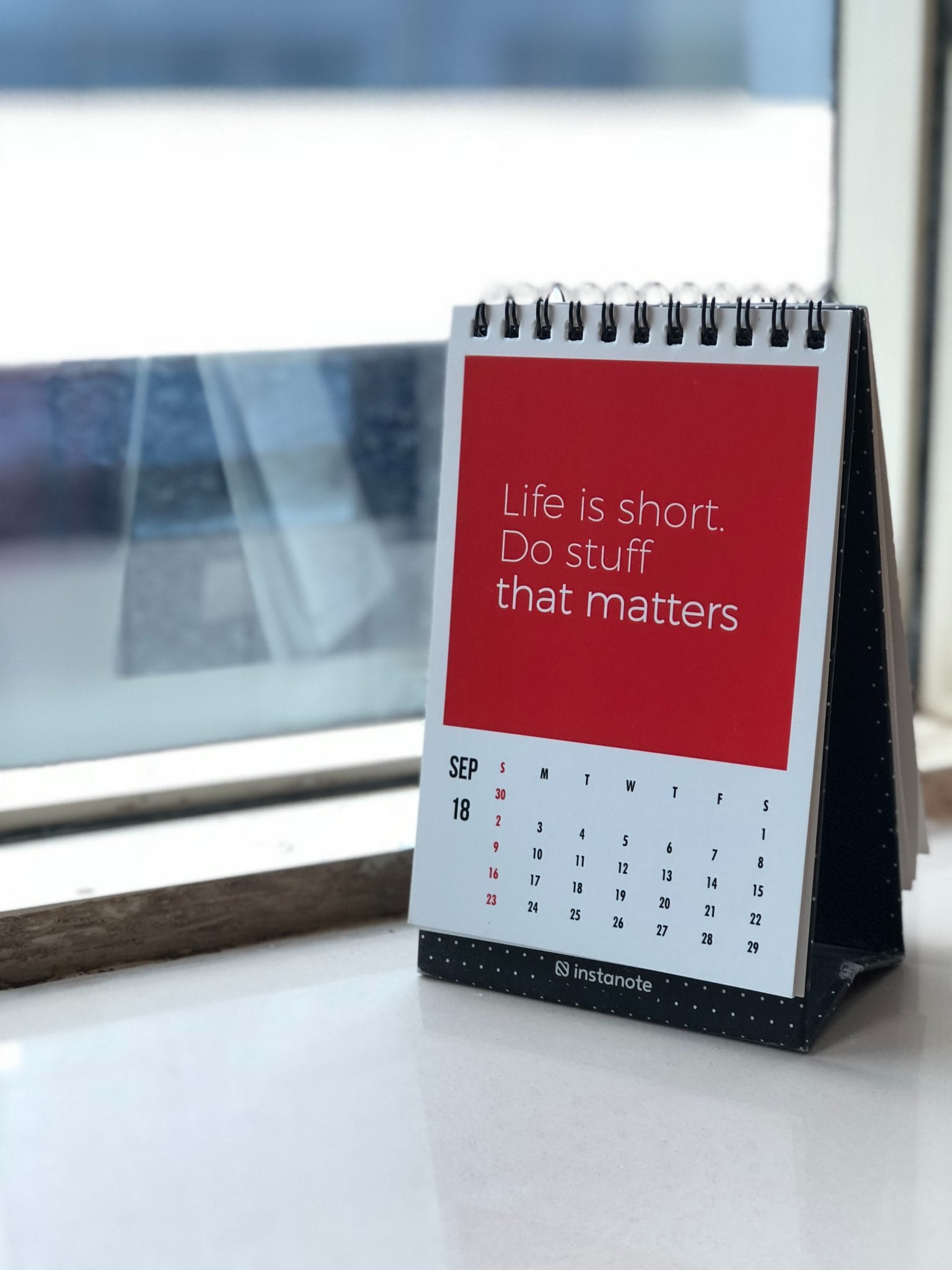 Life Is Short message on desk calendar