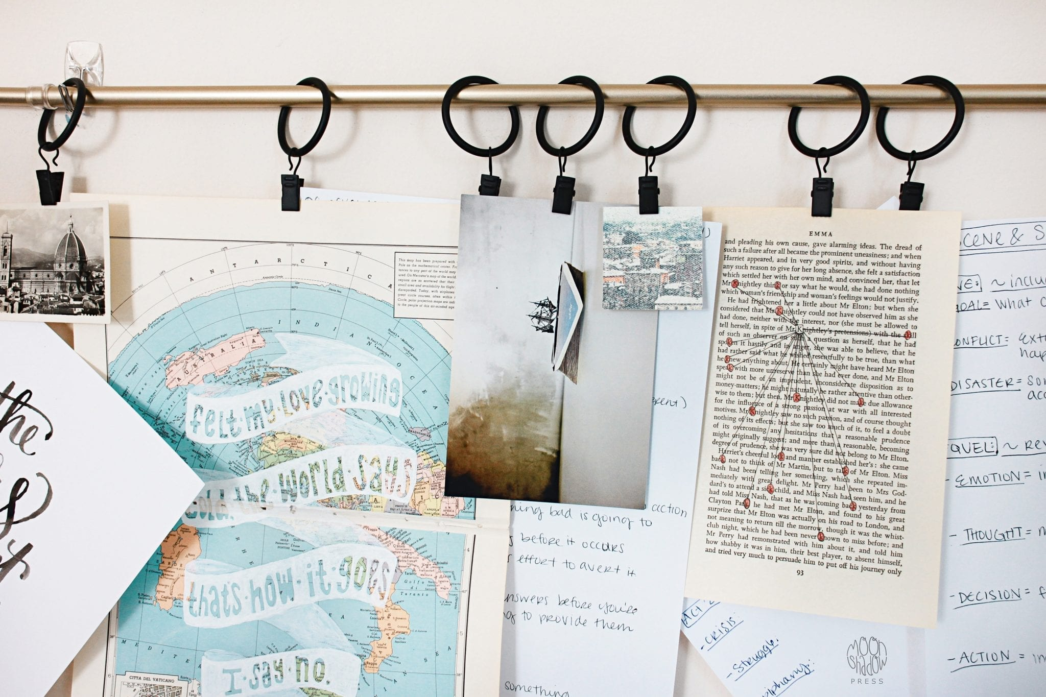 Travel items hanging from rod