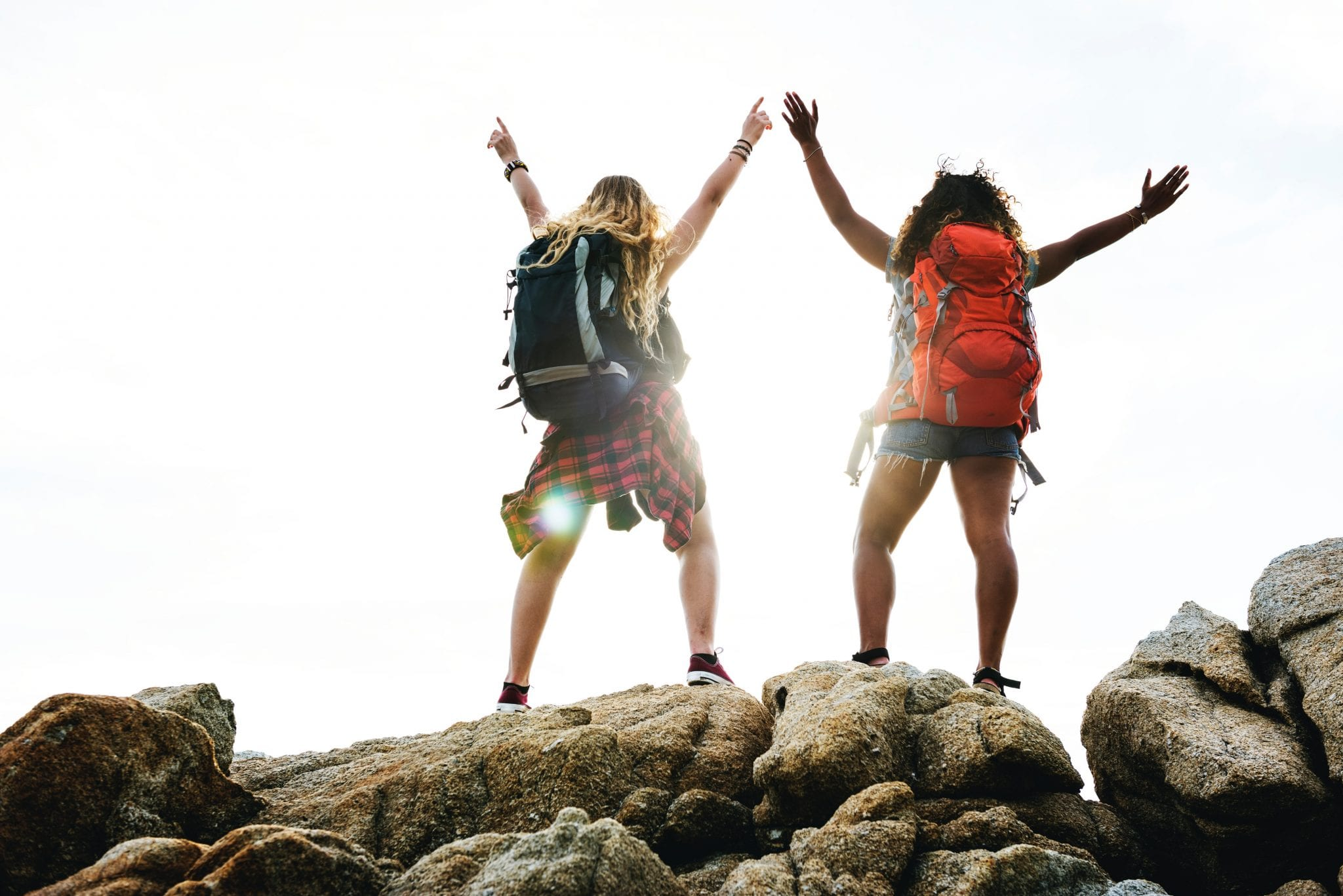 Two women standing on rock
